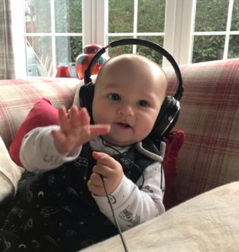Dale Middleton DJ baby with headphones